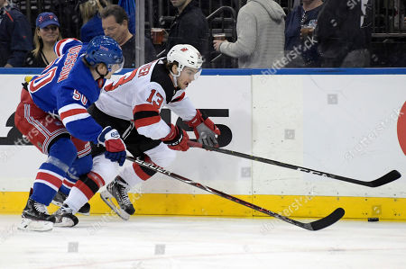 f8c70cc14e1 New Jersey Devils center Nico Hischier (13) and New York Rangers center  Lias Andersson