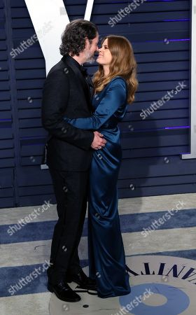Stock Photo of Amy Adams (R) and Darren Le Gallo (L)pose at the 2019 Vanity Fair Oscar Party following the 91th annual Academy Awards ceremony, in Beverly Hills, California, USA, 24 February 2019. The Oscars are presented for outstanding individual or collective efforts in 24 categories in filmmaking. The Oscars are presented for outstanding individual or collective efforts in 24 categories in filmmaking.