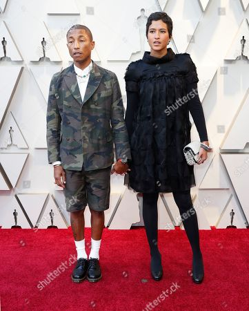 Pharrell Williams (L) and Helen Lasichanh arrive for the 91st annual Academy Awards ceremony at the Dolby Theatre in Hollywood, California, USA, 24 February 2019. The Oscars are presented for outstanding individual or collective efforts in 24 categories in filmmaking.
