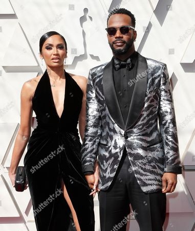 Stock Photo of Regina Perera (L) and her husband rapper Juicy J (R) arrive for the 91st annual Academy Awards ceremony at the Dolby Theatre in Hollywood, California, USA, 24 February 2019. The Oscars are presented for outstanding individual or collective efforts in 24 categories in filmmaking.