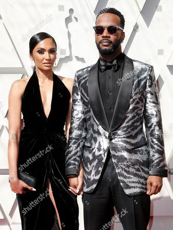 Regina Perera (L) and her husband rapper Juicy J (R) arrive for the 91st annual Academy Awards ceremony at the Dolby Theatre in Hollywood, California, USA, 24 February 2019. The Oscars are presented for outstanding individual or collective efforts in 24 categories in filmmaking.