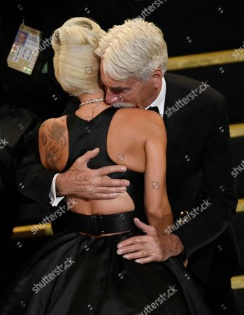 "Sam Elliott, Lady Gaga. Sam Elliott, right, embraces Lady Gaga, winner of the award for best original song for ""Shallow"" from ""A Star Is Born"" at the Oscars, at the Dolby Theatre in Los Angeles"