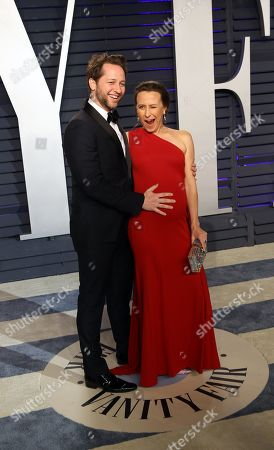 Derek Blasberg and Anne Wojcicki pose at the 2019 Vanity Fair Oscar Party following the 91st annual Academy Awards ceremony, in Beverly Hills, California, USA, 24 February 2019. The Oscars are presented for outstanding individual or collective efforts in 24 categories in filmmaking. The Oscars are presented for outstanding individual or collective efforts in 24 categories in filmmaking.