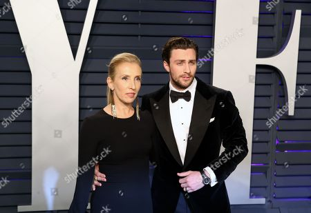 Sam Taylor-Johnson (L) and Aaron Taylor-Johnson (R) poses at the 2019 Vanity Fair Oscar Party following the 91st annual Academy Awards ceremony, in Beverly Hills, California, USA, 24 February 2019. The Oscars are presented for outstanding individual or collective efforts in 24 categories in filmmaking. The Oscars are presented for outstanding individual or collective efforts in 24 categories in filmmaking.