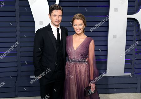 Topher Grace (L) and Ashley Hinshaw (R) pose at the 2019 Vanity Fair Oscar Party following the 91st annual Academy Awards ceremony, in Beverly Hills, California, USA, 24 February 2019. The Oscars are presented for outstanding individual or collective efforts in 24 categories in filmmaking. The Oscars are presented for outstanding individual or collective efforts in 24 categories in filmmaking.
