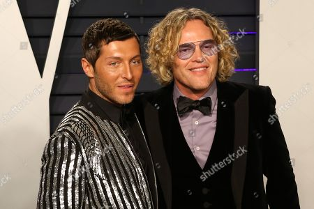 Stock Picture of Peter Dundas (R) and Evangelo Bousis attend the 2019 Vanity Fair Oscar Party following the 91st annual Academy Awards ceremony, in Beverly Hills, California, USA, 24 February 2019. The Oscars are presented for outstanding individual or collective efforts in 24 categories in filmmaking.