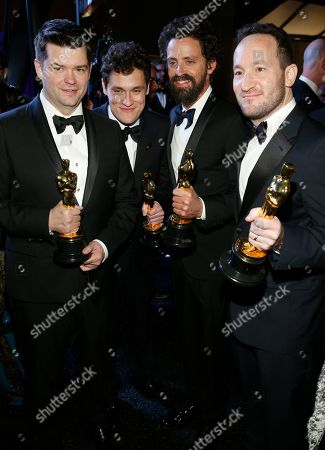 """Christopher Miller, Phil Lord, Bob Persichetti, Rodney Rothman. Christopher Miller, from left, Phil Lord, Bob Persichetti and Rodney Rothman, winners of the award for best animated feature film for """"Spider-Man: Into the Spider-Verse"""", attend the Governors Ball after the Oscars, at the Dolby Theatre in Los Angeles"""