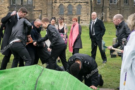 Ep 9702 Monday 25th February 2019  Shona Ramsey, as played by Julia Goulding, and Billy Mayhew, as played by Daniel Brocklebank, are shocked when Macca, as played by Gareth Berliner, and one of the undertakers attack the prison guard and free Clayton Hibbs, as played by Callum Harrison. Billy wrestles Macca to the ground but Clayton escapes.