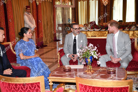 Stock Image of Prince Harry and Meghan Duchess of Sussex meet with King Mohammed VI of Morocco and Crown Prince Moulay Hassan at the King's Residence