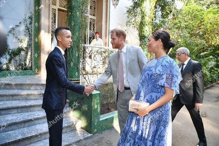 Stock Picture of Prince Harry and Meghan Duchess of Sussex are greeted by Crown Prince Moulay Hassan upon arriving at the King's Residence