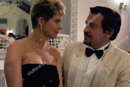 Andrea Osvart as Berta Molnar and Ricky Memphis as Walter Bianchini
