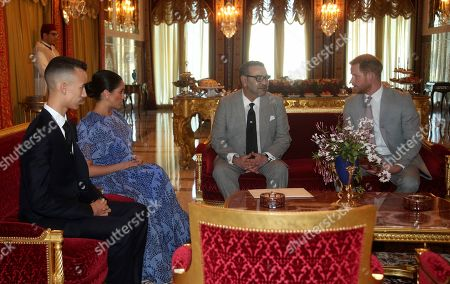 Prince Harry, right, and Meghan Duchess of Sussex, second left, sit during a private audience with King Mohammed VI of Morocco, centre and his son theCrown Prince of Morocco, Prince Moulay Hassan, left, at his residence, on the third day of the tour of Morocco, in Rabat