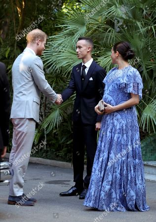 Prince Harry, left, shake hands with the Crown Prince of Morocco, Prince Moulay Hassan, as Meghan Duchess of Sussex, stands at right, after leaving the residence of King Mohammed VI of Morocco, on the third day of their tour of Morocco, in Rabat