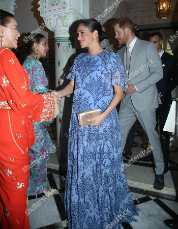 Prince Harry and Meghan Duchess of Sussex, are greeted by Princess Lalla Meryem of Morocco second left and Princess Lalla Hasna of Morocco, at the residence of King Mohammed VI of Morocco, on the third day of their tour of Morocco, in Rabat