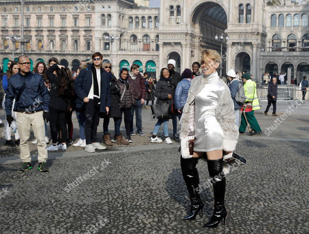 In this picture taken on Tuesday, Feb.19, 2019, Italian showgirl Justine Matera poses for photographers after the Alberto Zambelli women's Fall-Winter 2019-2020 fashion show, that was presented in Milan, Italy. Fashion is a creative endeavor with no real boundaries, and outside each luxury runway venue, vibrant scenes unfold amid the confluence of influencers, fashion editors, celebrity guests, street photographers and hopeful selfie-snappers