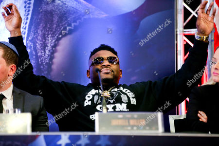 Jarrell Miller appears bored and holds up his hands - Anthony Joshua & Jarrell Miller Press Conference ahead of their fight at Madison Square Garden on 01/06/2019 Anthony Joshua & Jarrell Miller Press Conference ahead of their fight on 01/06/2019 at Madison Square Garden.