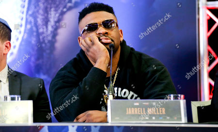 Jarrell Miller appears bored  - Anthony Joshua & Jarrell Miller Press Conference ahead of their fight at Madison Square Garden on 01/06/2019 Anthony Joshua & Jarrell Miller Press Conference ahead of their fight on 01/06/2019 at Madison Square Garden.