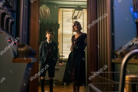 Aidan Gallagher as Number Five and Kate Walsh as The Handler
