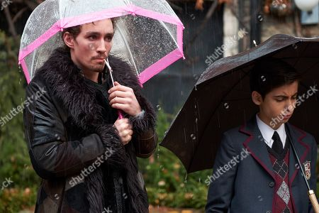 Robert Sheehan as Klaus Hargreeves and Aidan Gallagher as Number Five
