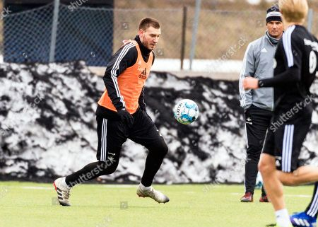 Rosenborg's Danish striker Nicklas Bendtner (L) performs during his team's training session in Trondheim, Norway, 25 February 2019. Bendtner returned to Trondheim after serving a 50-day sentence for assaulting a taxi driver in Denmark.