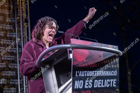 The deputy for CUP Natalia Sanchez is seen speaking during the protest