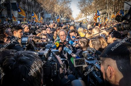 President of the Government of Catalonia Joaquim Torra is seen surrounded by journalists doing a press conference during the protest
