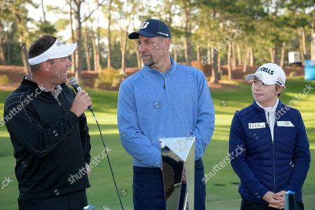 Michael Flaskey, CEO of Diamond Resorts International, left, talks to John Smoltz, center, who finished as the top celebrity, as winner Eun-Hee Ji, of South Korea, right, watches after the final round of the Tournament of Champions LPGA golf tournament, in Lake Buena Vista, Fla
