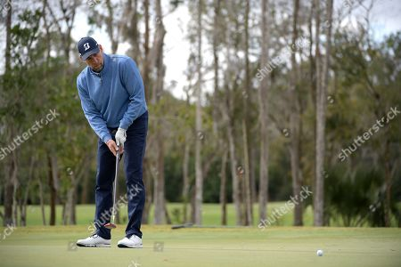 John Smoltz watches a putt on the first green during the final round of the Tournament of Champions LPGA golf tournament, in Lake Buena Vista, Fla