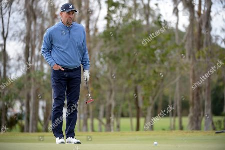 John Smoltz lines up a putt on the first green during the final round of the Tournament of Champions LPGA golf tournament, in Lake Buena Vista, Fla