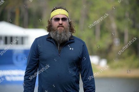Willie Robertson walks off the 18th green after putting during the final round of the Tournament of Champions LPGA golf tournament, in Lake Buena Vista, Fla