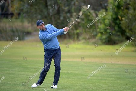 John Smoltz hits from the second fairway during the final round of the Tournament of Champions LPGA golf tournament, in Lake Buena Vista, Fla
