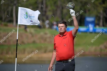 Michael Waltrip acknowledges the crowd after making a putt on the 18th green during the final round of the Tournament of Champions LPGA golf tournament, in Lake Buena Vista, Fla