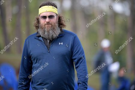Willie Robertson lines up a putt on the 18th green during the final round of the Tournament of Champions LPGA golf tournament, in Lake Buena Vista, Fla