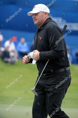 Roger Clemens walks off the 18th green after making a putt during the final round of the Tournament of Champions LPGA golf tournament, in Lake Buena Vista, Fla