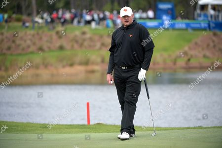 Stock Image of Roger Clemens waits to putt on the 18th green during the final round of the Tournament of Champions LPGA golf tournament, in Lake Buena Vista, Fla