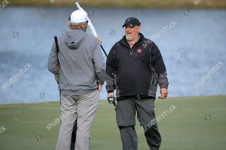 Comedian Daniel Lawrence Whitney, right, known as Larry the Cable Guy, talks with singer Toby Keith after making their putts on the 17th green during the final round of the Tournament of Champions LPGA golf tournament, in Lake Buena Vista, Fla