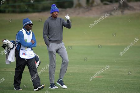Ray Allen, right, walks down the 17th fairway during the final round of the Tournament of Champions LPGA golf tournament, in Lake Buena Vista, Fla
