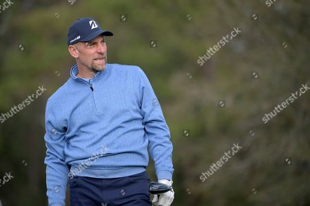 John Smoltz watches his tee shot on the 17th hole during the final round of the Tournament of Champions LPGA golf tournament, in Lake Buena Vista, Fla