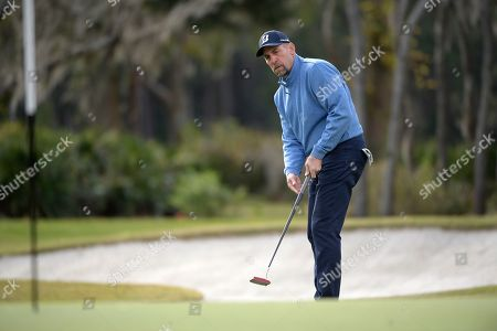 Stock Image of John Smoltz watches a putt on the 16th green during the final round of the Tournament of Champions LPGA golf tournament, in Lake Buena Vista, Fla