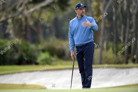 Stock Picture of John Smoltz lines up a putt on the 16th green during the final round of the Tournament of Champions LPGA golf tournament, in Lake Buena Vista, Fla