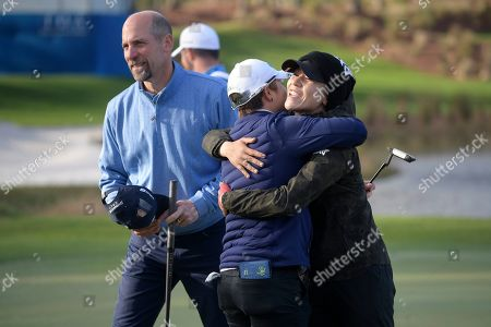 Eun-Hee Ji, center, is congratulated by Lydia Ko, right, and John Smoltz after putting on the 18th green to win the Tournament of Champions LPGA golf tournament, in Lake Buena Vista, Fla