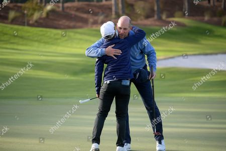 Stock Photo of Eun-Hee Ji, left, is congratulated by John Smoltz after putting on the 18th green to win the Tournament of Champions LPGA golf tournament, in Lake Buena Vista, Fla
