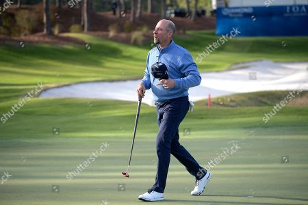 John Smoltz walks on the 18th green after making a putt during the final round of the Tournament of Champions LPGA golf tournament, in Lake Buena Vista, Fla