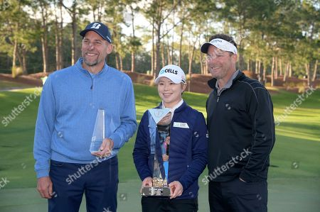Michael Flaskey, CEO of Diamond Resorts International, right, poses with Eun-Hee Ji, of South Korea, center, and former professional baseball player John Smoltz after the final round of the Tournament of Champions LPGA golf tournament, in Lake Buena Vista, Fla. Eun-Hee Ji won the tournament and Smoltz was the top celebrity finisher