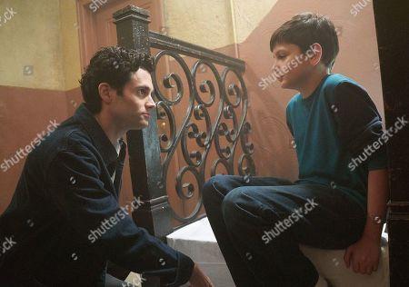 Penn Badgley as Joe Goldberg and Luca Padovan as Paco