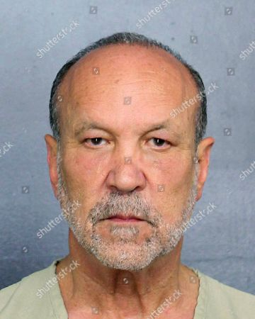Stock Image of Made available by the Broward County Sheriff's Office, Fla., shows Ron Book under arrest. Book, a prominent lobbyist, is facing drunk-driving charges after an accident Sunday, Feb. 24, where property damage was recorded
