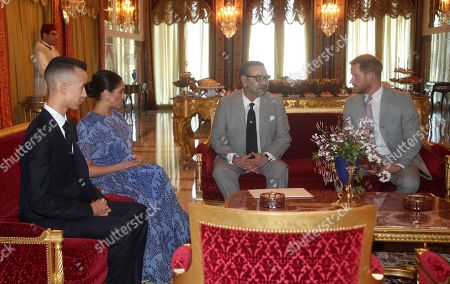 The Duke (R) and Duchess (2-L) of Sussex meet with the King Mohammed VI of Morocco (2-R) and his son The Crown Prince of Morocco, Moulay Hassan (L) at his residence in Rabat, during a private audience with him, on the third day of their tour of Morocco, 25 February 2019.