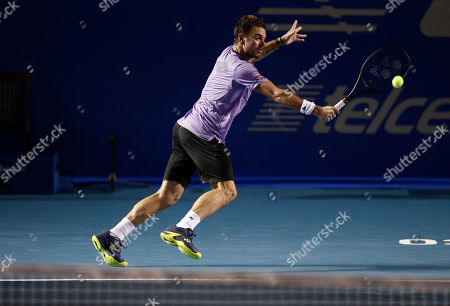 Stock Image of Stan Wawrinka of Switzerland returns a ball in his match against Ryan Harrison of the U.S., during round one play at the Mexican Tennis Open in Acapulco, Mexico