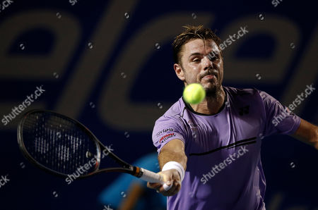 Stan Wawrinka of Switzerland returns a ball in his match against Ryan Harrison of the U.S., during round one play at the Mexican Tennis Open in Acapulco, Mexico