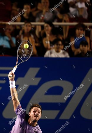 Stan Wawrinka of Switzerland serves against Ryan Harrison of the U.S. during round one play at the Mexican Tennis Open in Acapulco, Mexico